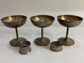 A set of three George V silver trophy cups, maker Elkington & Co, Birmingham 1928, 1929, 1930, all