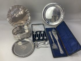 A collection of silver plated wares, including a salver, a cased pair of fish servers, a cased set