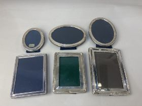 A pair of Elizabeth II oval silver photograph frames, makers Carr's of Sheffield Ltd, 1996, aperture