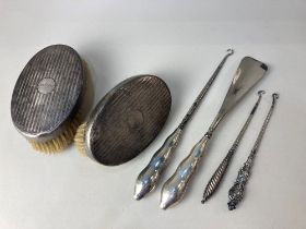 A pair of George V silver backed clothes brushes, maker Levi & Salaman, Birmingham 1925, (a/f