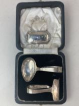 An Elizabeth II cased silver christening set of spoon and pusher, makers Viner's of Sheffield