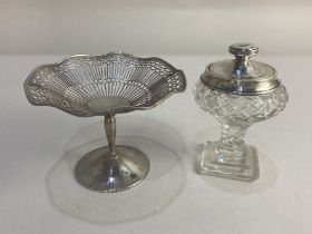 A silver pedestal sweets dish, marks worn, together with a silver lidded and mounted cut glass