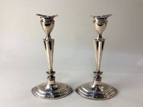 A pair of George V silver candlesticks, maker Williams Ltd, Birmingham 1920, of oval form with