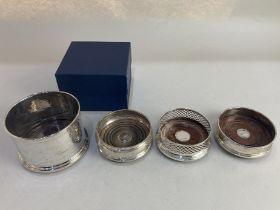 Three Elizabeth II silver bottle coasters, various makers comprising Francis Howard Ltd, Sheffield