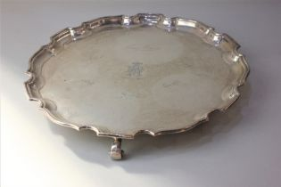 An Edward VIII silver salver with pie crust border, engraved monogram and presentation signatures,