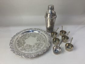 A silver plated salver, with oak leaf and acorn design, a silver plated cocktail shaker, and six