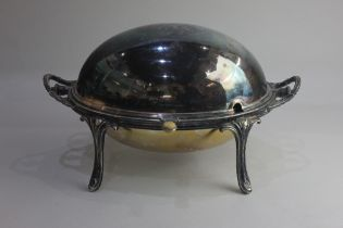 A silver plated two handled revolving dome top oval tureen with two liners on four scroll legs 34cm