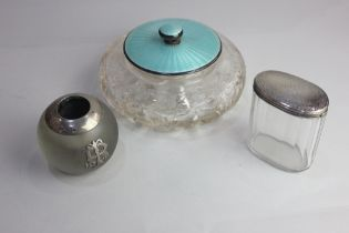 A George V silver and pale blue enamel lidded circular glass dressing table box, 17cm another silver