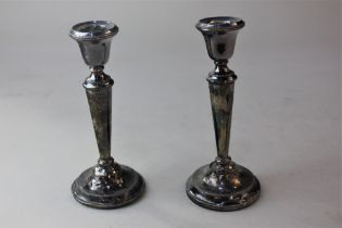 A pair of modern silver dwarf candlesticks on loaded circular bases, Birmingham 1974 and another