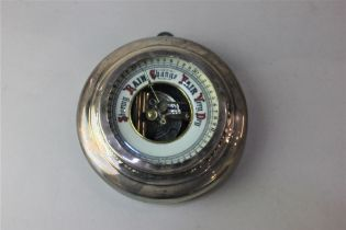 A George V silver mounted circular wall barometer hallmarked London 1927 (a/f) 14cm
