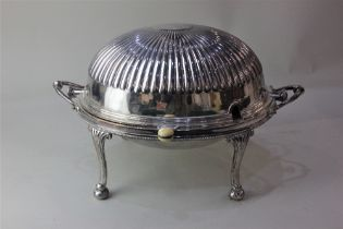 A silver plated two handled revolving oval domed tureen with fitted dish and liner, reeded top on