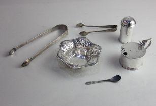 A George V silver circular mustard pot Birmingham 1938, a cylindrical pepper pot, Chester 1938, a