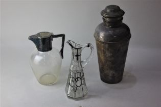 A silver plated cocktail shaker 24cm a silver plate mounted glass claret jug and a silver overlay