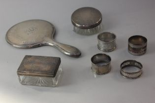 Two Victorian silver lidded glass dressing table pots, one circular, the other rectangular, both