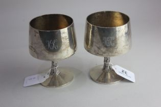 A pair of late 20th century silver goblets by Christopher Lawrence, gilt interiors on bark