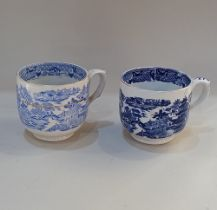 Two similar large blue and white cups with transfer printed Willow pattern style decoration, with