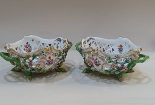 A pair of Mesissen porcelain two handled baskets pierced oval form and floral encrusted on