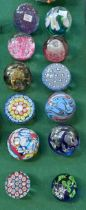 A collection of twelve glass paperweights