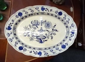 A Victorian large blue and white ceramic serving plate decorated with Onion pattern, (af) 58cm