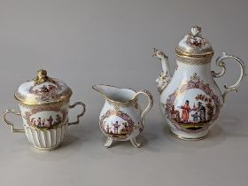 A Meissen style porcelain chocolate pot, cream jug and chocolate cup and cover, decorated with