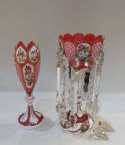 A Bohemian ruby and white overlay glass table lustre decorated with floral panels, 32cm and a