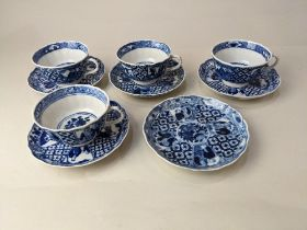 A set of four blue and white porcelain tea cups and five saucers, probably Royal Worcester, with