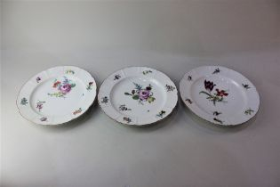 Three Ludwigsberg porcelain plates, each with floral decoration on white ground, 23.5cm diameter