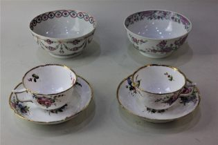 A pair of Spode porcelain tea cups and saucers with moulded floral decoration and gilt borders