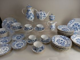 A matched collection of Meissen porcelain onion pattern tea and table wares, to include teapot, milk