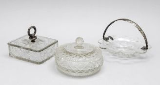 Set of three pieces, 20th c., round jar, butter dish and flower-shaped bowl, each clear glass with