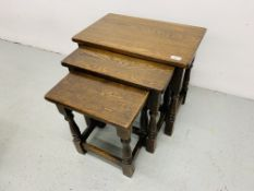 NEST OF THREE GRADUATED OAK OCCASIONAL TABLES