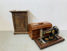A VINTAGE JONES HAND OPERATED SEWING MACHINE ALONG WITH AN OAK VINTAGE SINGLE DOOR CABINET