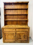 RUSTIC ANTIQUE PINE FARMHOUSE DRESSER THE TWO DOOR BASE WITH TWO DRAWERS AND OPEN SHELVED TOP.