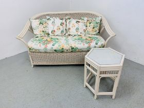 A WICKER AND CANE CONSERVATORY SOFA AND CANE HEXAGONAL OCCASIONAL TABLE