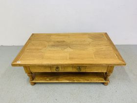 A BAKER BEDFORD HARDWOOD AND FLAGSTONE INSET TWO TIER COFFEE TABLE - 130 CM X 80 CM.