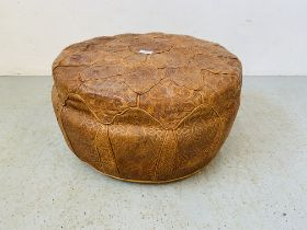 A REAL TAN LEATHER POUFFE WITH EMBOSSED DECORATION