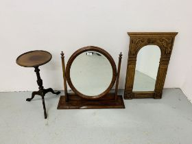 A WALL MIRROR IN HARDWOOD CARVED COUNTRY AND EASTERN STYLE FRAME - W 46CM.