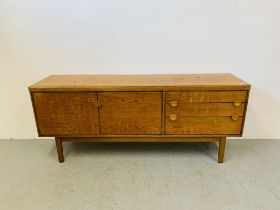 A RETRO TEAK FINISH SIDEBOARD WITH THREE DRAWERS AND TWO CABINET DOORS - LENGTH 184CM. DEPTH 45CM.