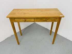 A SMALL LIGHT OAK TWO DRAWER SIDE TABLE 85CM X 34CM