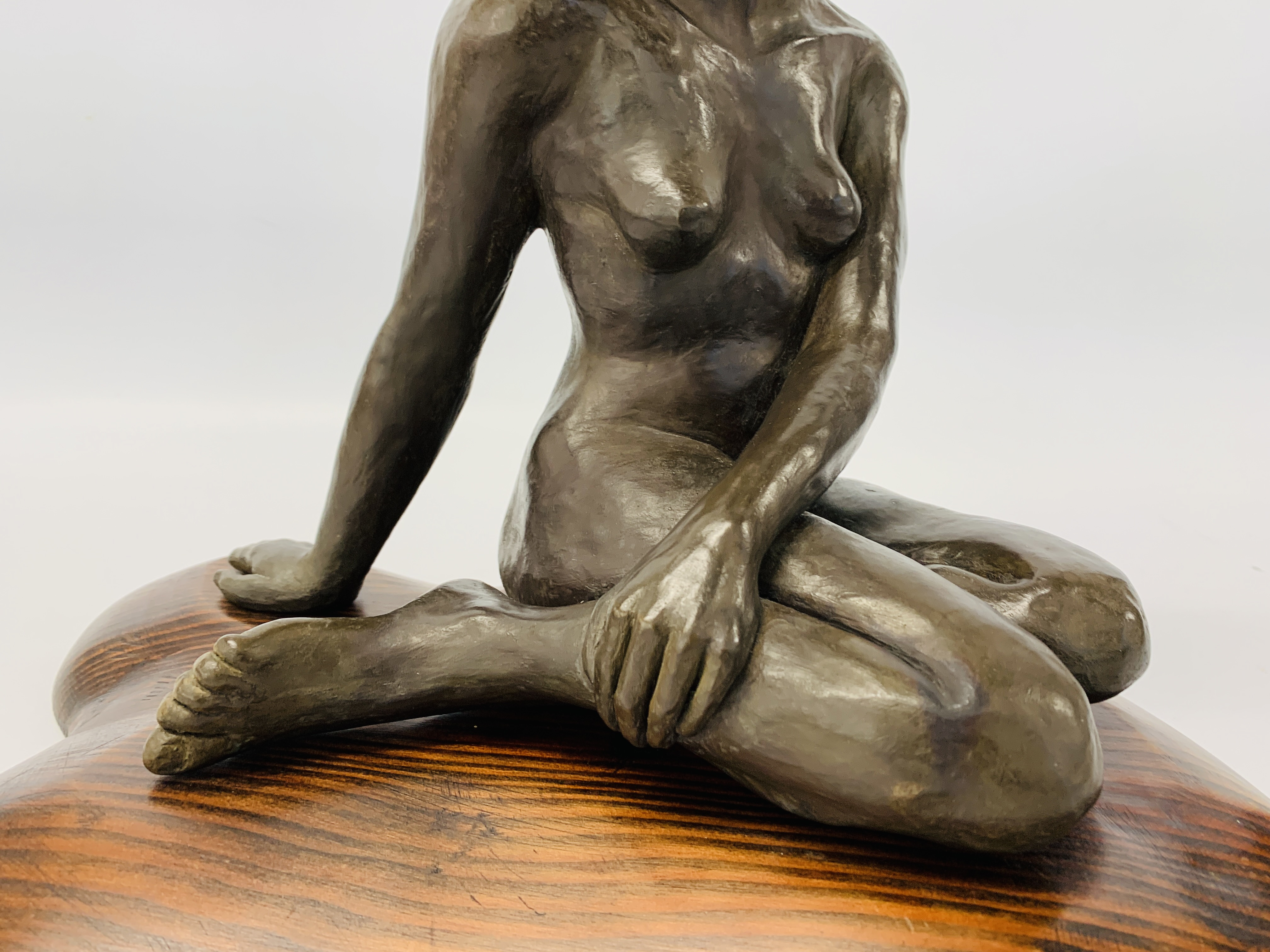 A BRONZED RESIN SCULPTURE OF A SEATED WOMAN BY SONIA DOBBS ON PINE BASE - HEIGHT 33.5 CM. - Image 3 of 8