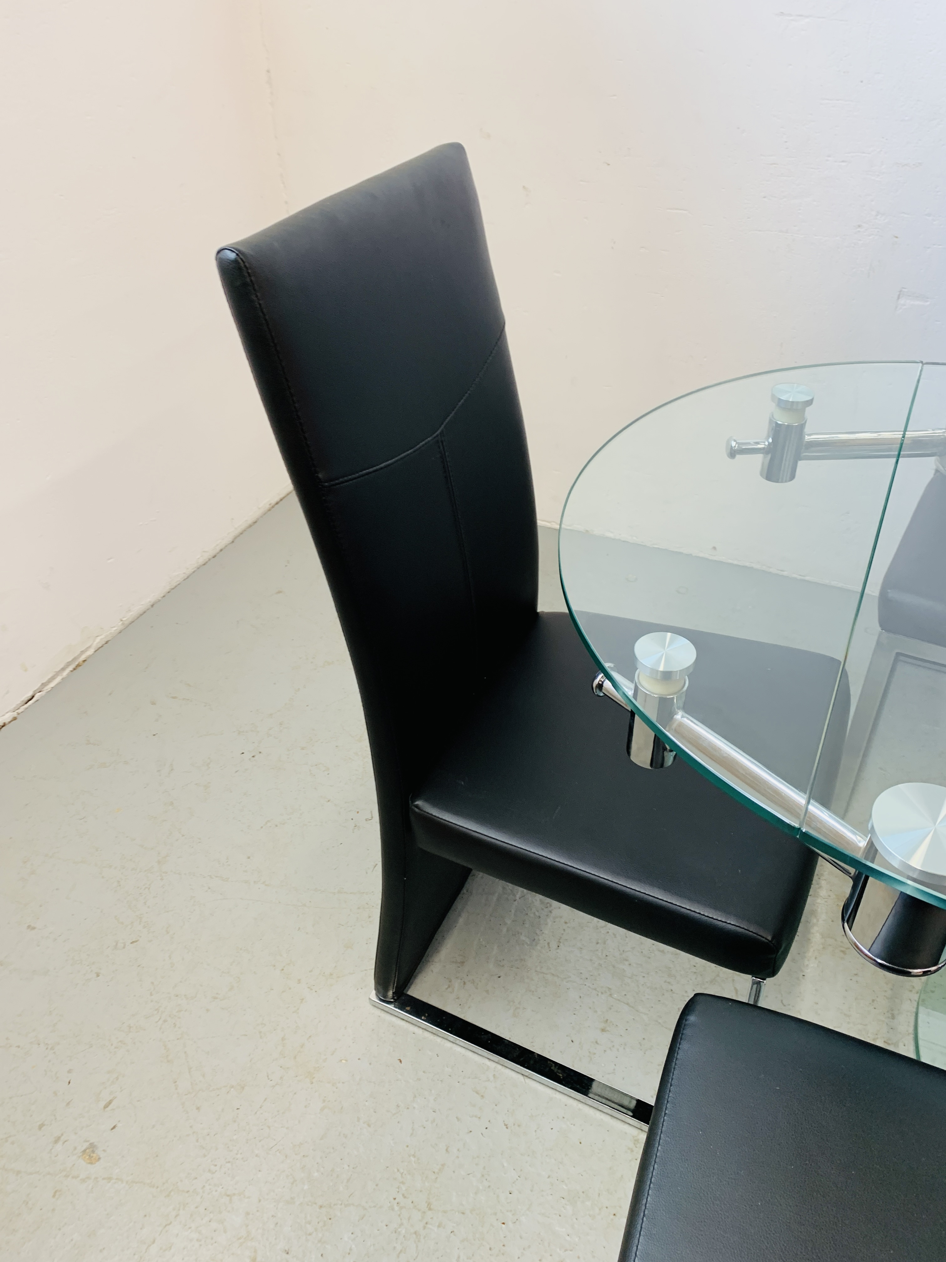 A DESIGNER GLASS AND CHROME PEDESTAL DINING TABLE WITH SET OF SIX CHROME FRAMED LEATHERETTE DINING - Image 10 of 17