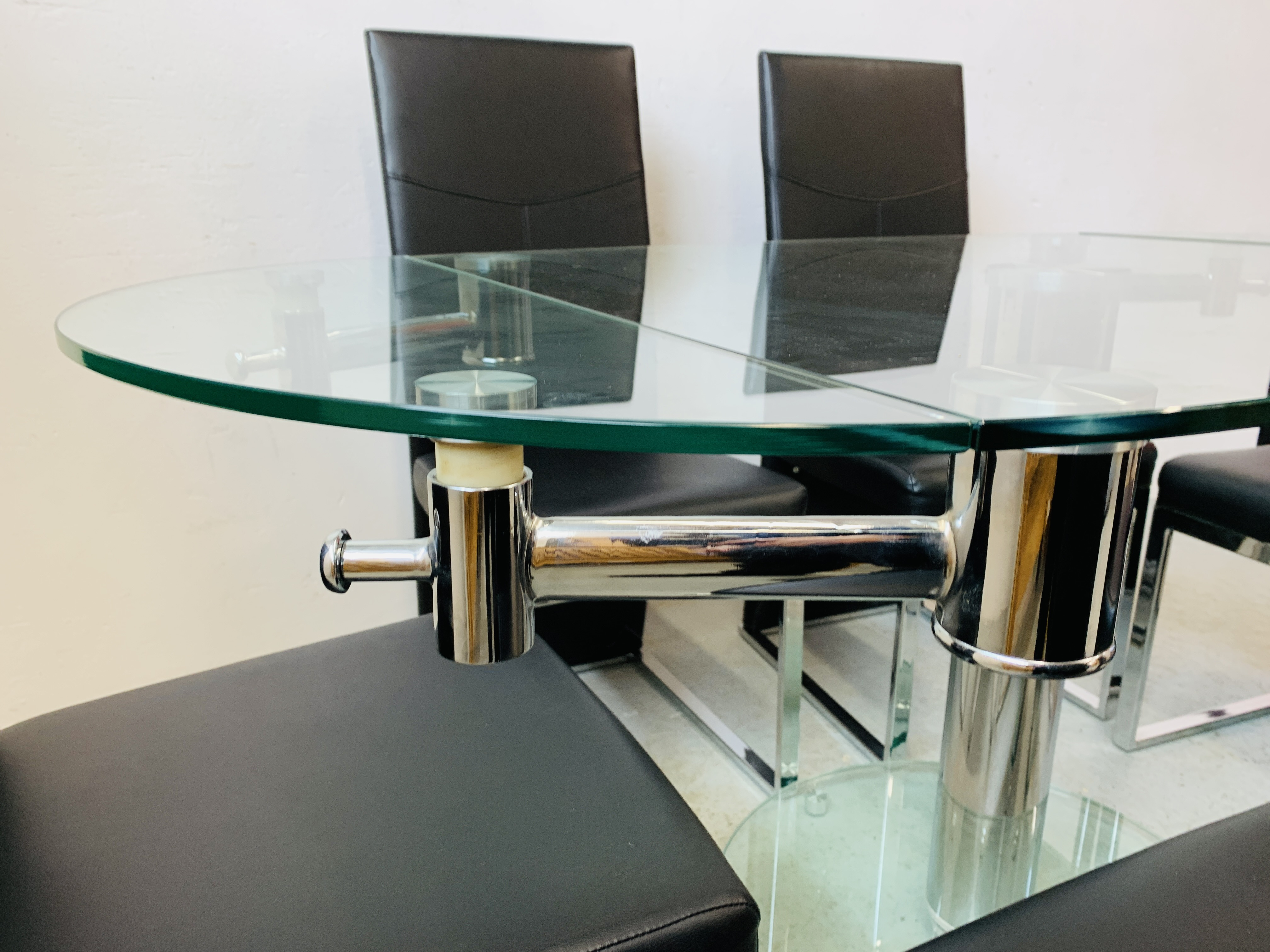 A DESIGNER GLASS AND CHROME PEDESTAL DINING TABLE WITH SET OF SIX CHROME FRAMED LEATHERETTE DINING - Image 11 of 17