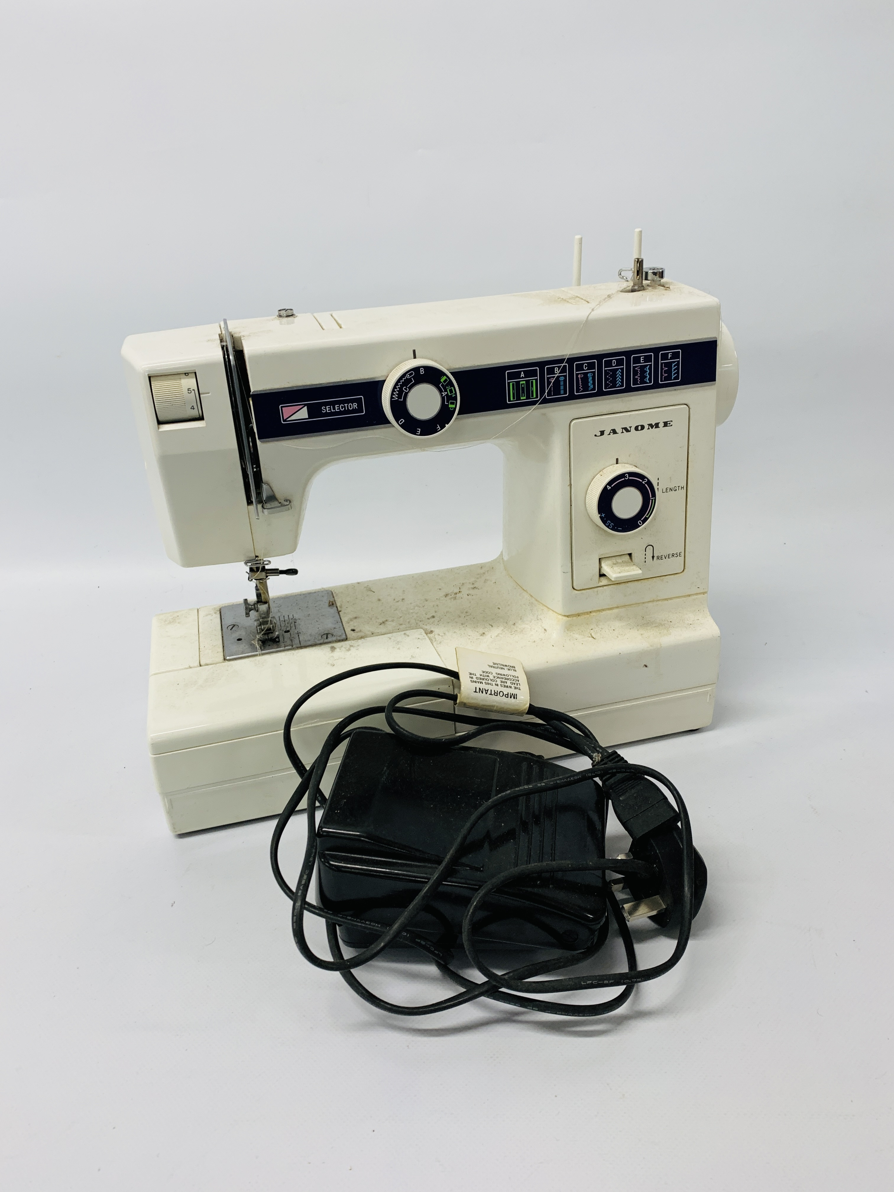 JANOME 110 SEWING MACHINE + VARIOUS KNITTING AND SEWING ACCESSORIES - SOLD AS SEEN