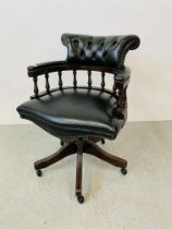 A BOTTLE GREEN BUTTON BACK LEATHER REVOLVING OFFICE CHAIR