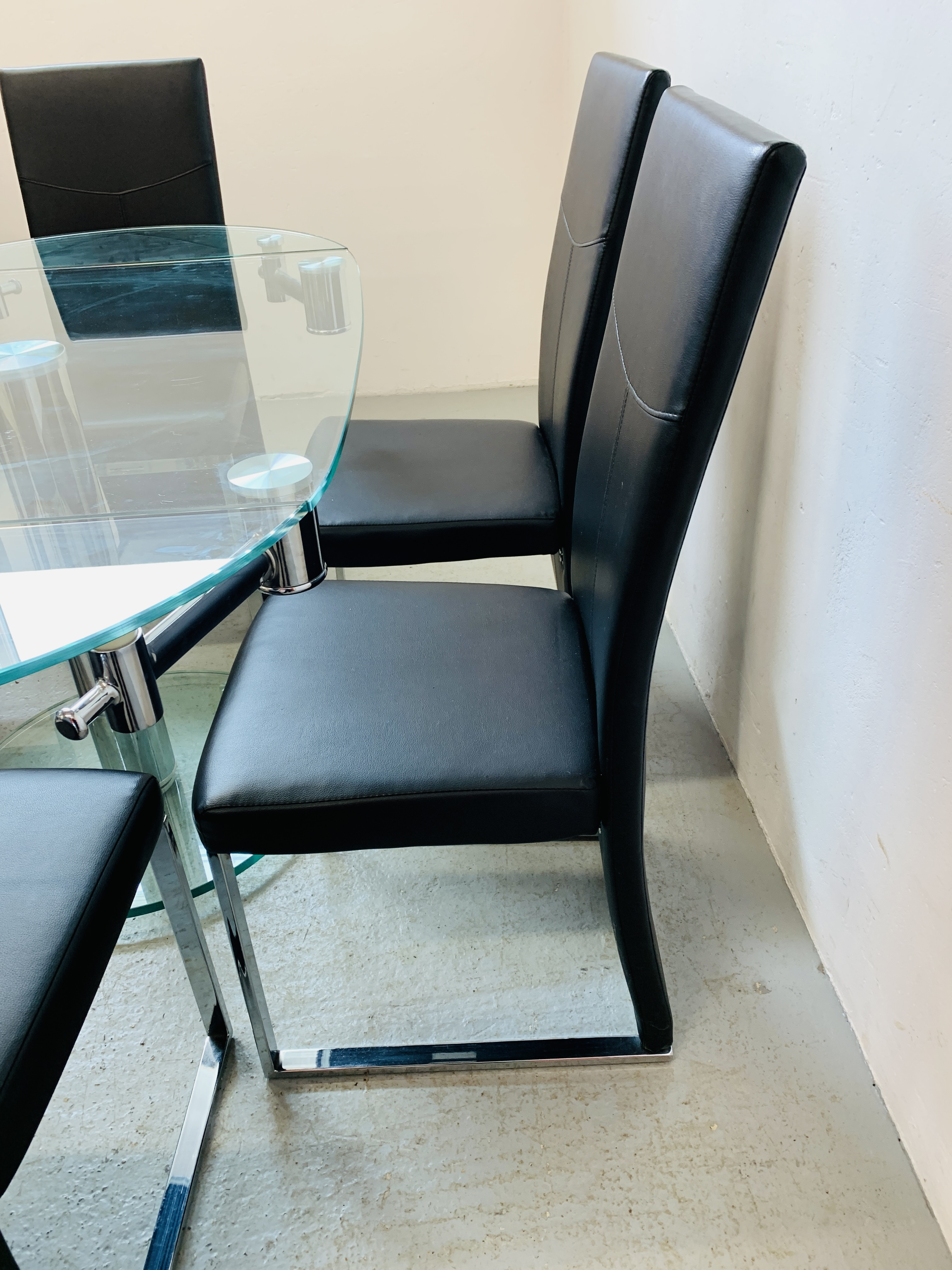 A DESIGNER GLASS AND CHROME PEDESTAL DINING TABLE WITH SET OF SIX CHROME FRAMED LEATHERETTE DINING - Image 6 of 17