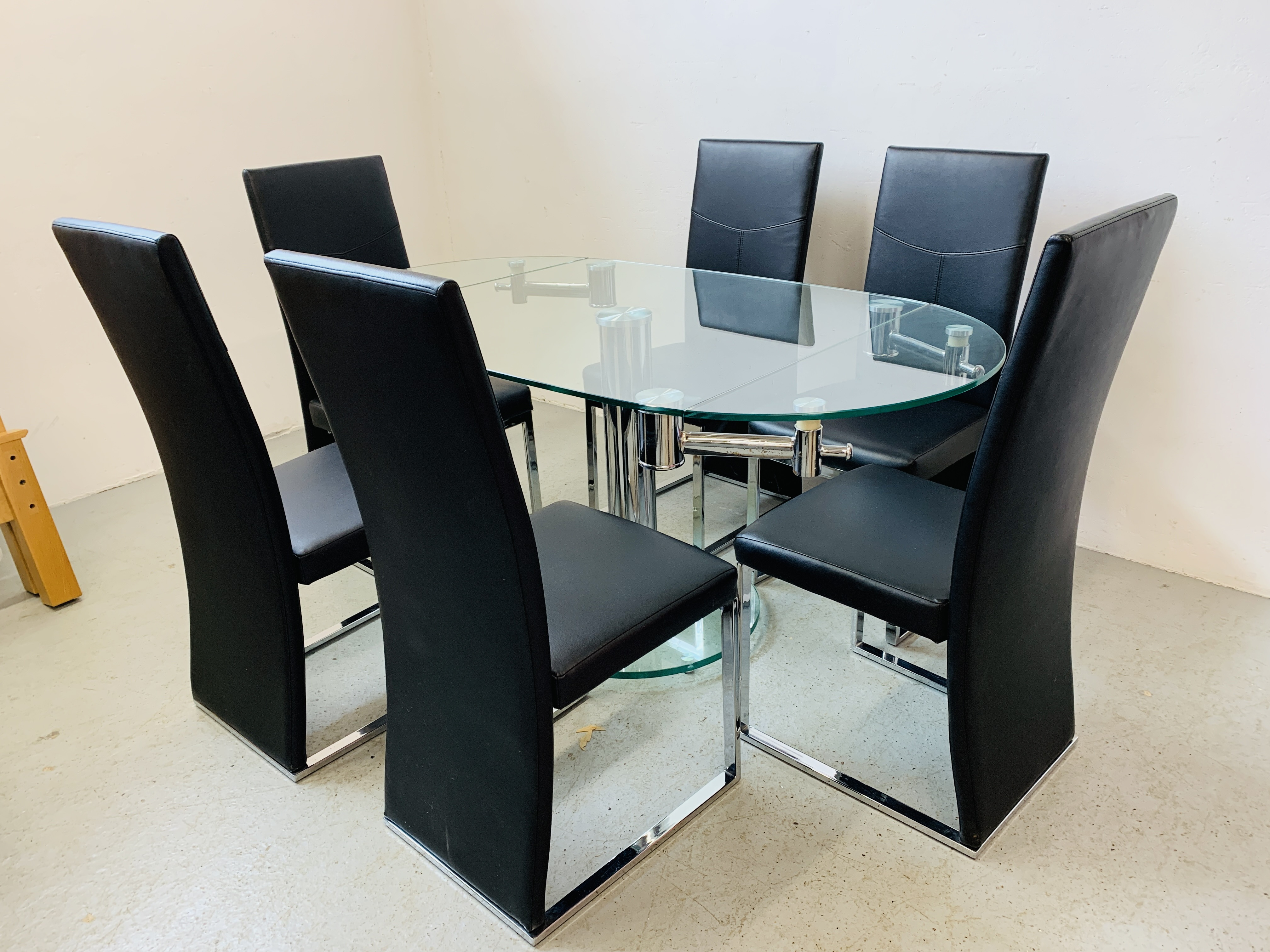 A DESIGNER GLASS AND CHROME PEDESTAL DINING TABLE WITH SET OF SIX CHROME FRAMED LEATHERETTE DINING - Image 2 of 17