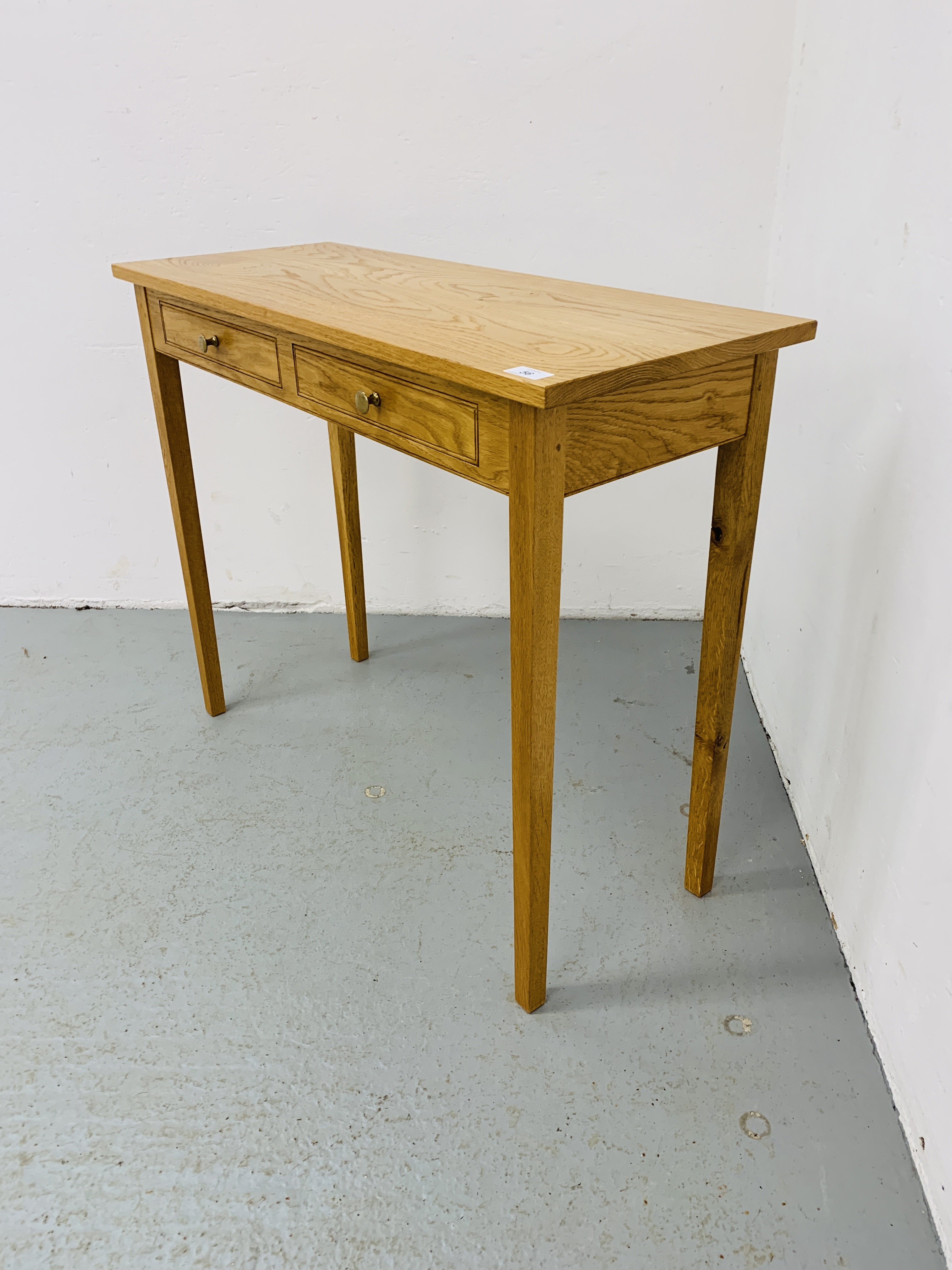 A SMALL LIGHT OAK TWO DRAWER SIDE TABLE 85CM X 34CM - Image 4 of 7