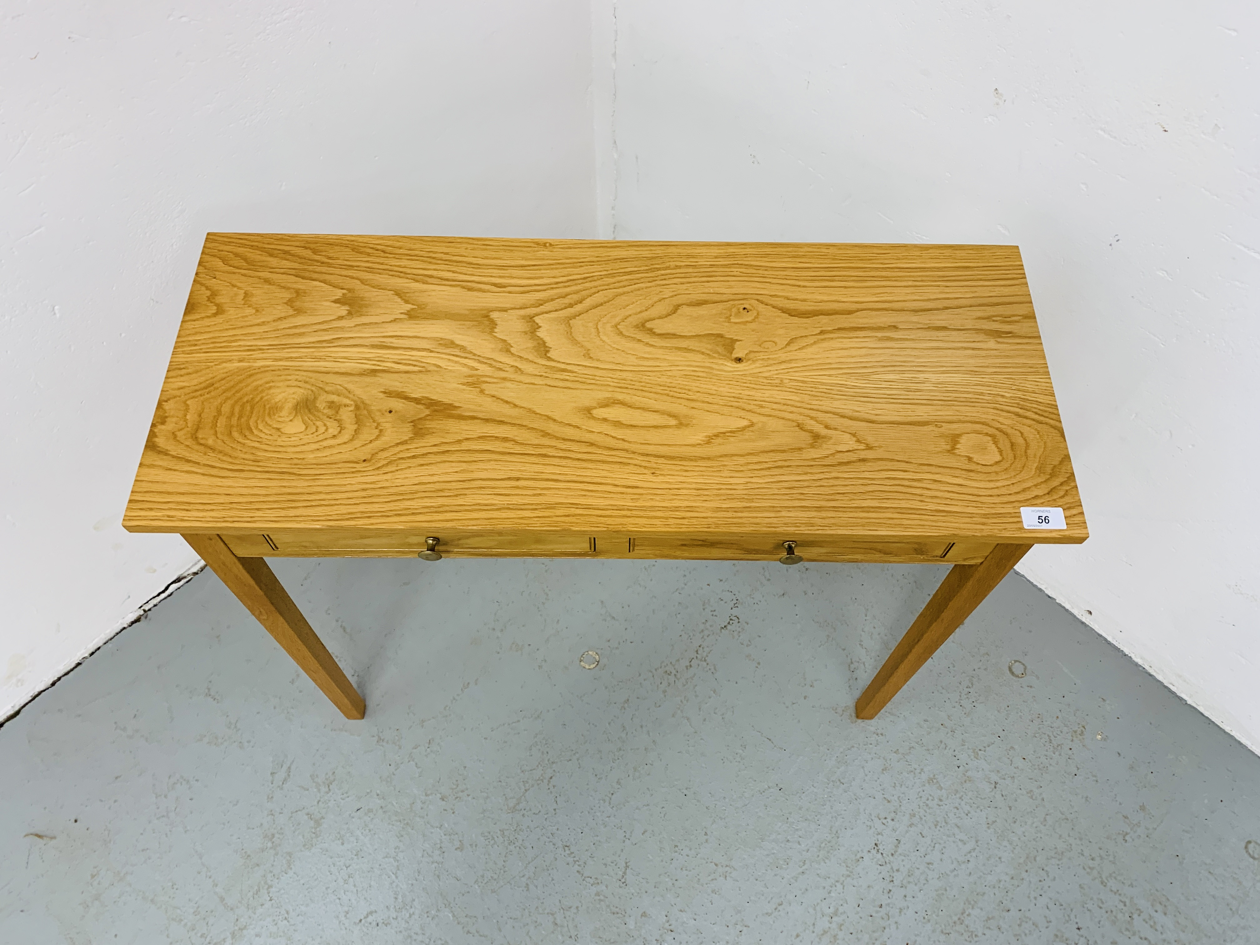 A SMALL LIGHT OAK TWO DRAWER SIDE TABLE 85CM X 34CM - Image 2 of 7
