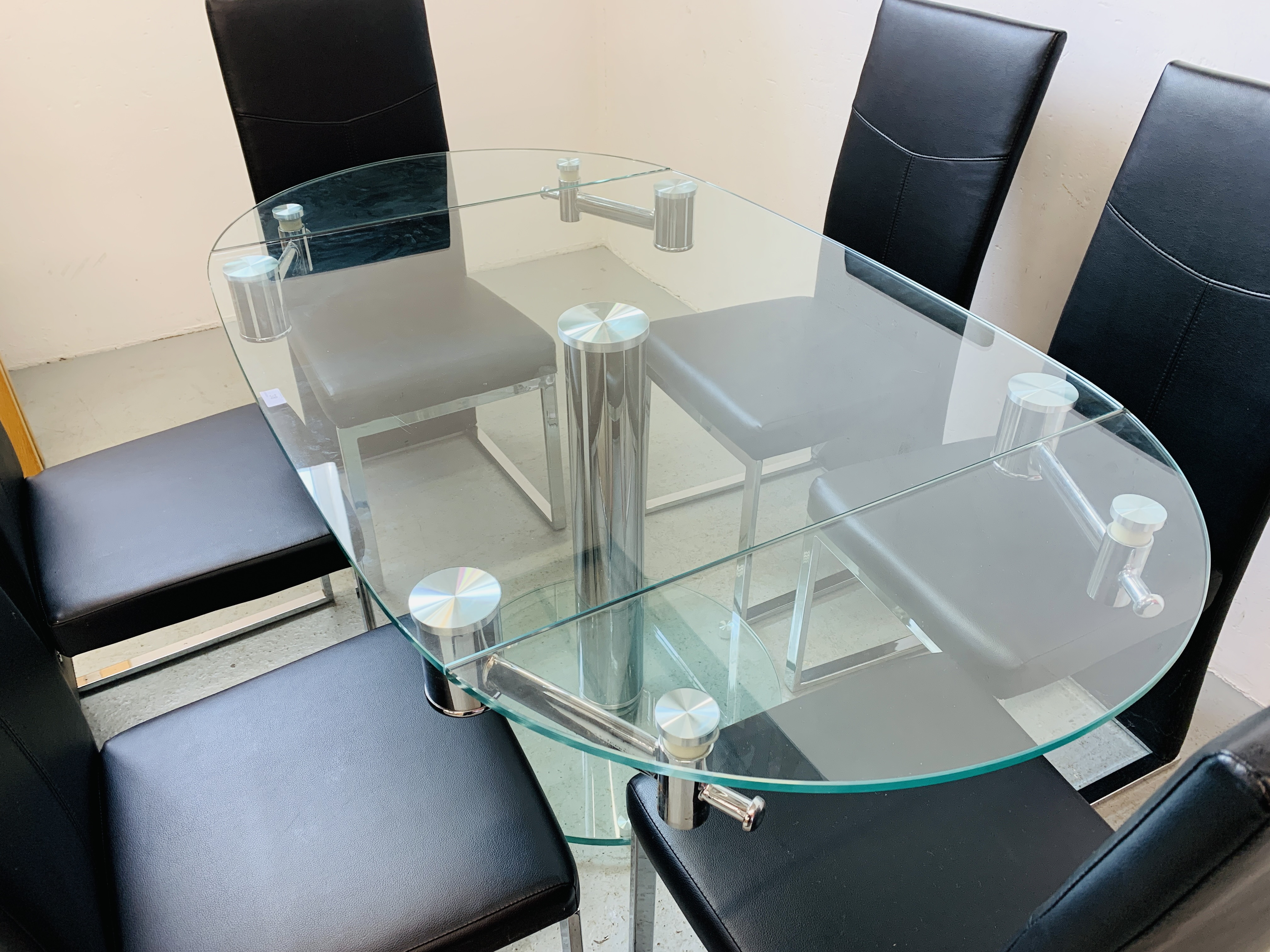 A DESIGNER GLASS AND CHROME PEDESTAL DINING TABLE WITH SET OF SIX CHROME FRAMED LEATHERETTE DINING - Image 5 of 17