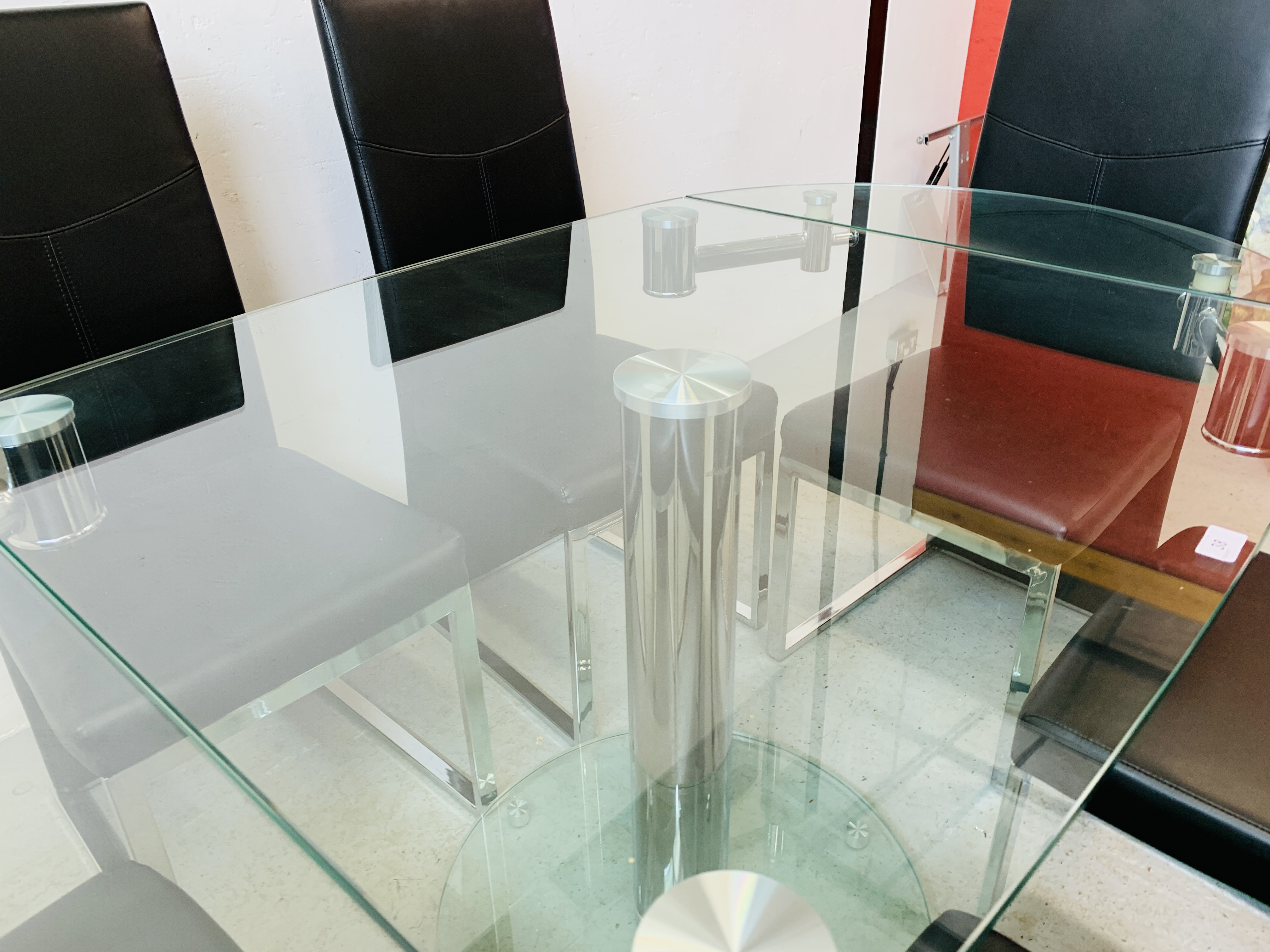 A DESIGNER GLASS AND CHROME PEDESTAL DINING TABLE WITH SET OF SIX CHROME FRAMED LEATHERETTE DINING - Image 13 of 17